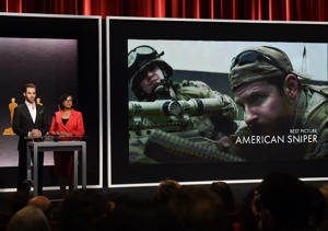 Hosts Chris Pine and Academy President Cheryl Boone announce the movie 'American Sniper' as one of the Oscar nominees for Best Picture during the Academy Awards Nominations Announcement at the Samuel Goldwyn Theater in Beverly Hills, California on January 15, 2015.