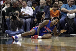 Detroit Pistons guard Brandon Jennings shouts after falling to the floor while playing against the Milwaukee Bucks during the second half of an NBA basketball game Saturday, Jan. 24, 2015, in Milwaukee.