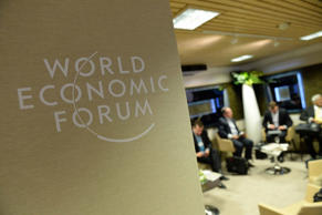 Conventioners talk with each other at the congress centre of the World Economic Forum.