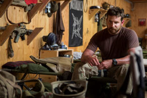 "Film still: Bradley Cooper in a scene from ""American Sniper."""