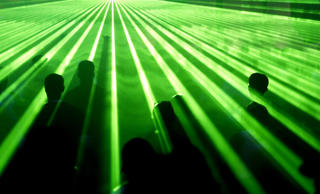 People dance amid green laser lights in Sao Paulo, Brazil.