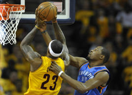 Jan 25, 2015; Cleveland, OH, USA; Cleveland Cavaliers forward LeBron James (23) drives to the basket against Oklahoma City Thunder forward Kevin Durant (35) in the first quarter at Quicken Loans Arena.