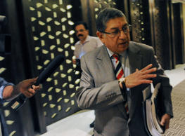 International Cricket Council (ICC) Chairman N. Srinivasan of India (C) gestures after attending a board meeting in Singapore on February 8, 2014.