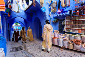 People stroll through the souk in Chefchaouen, Morocco.