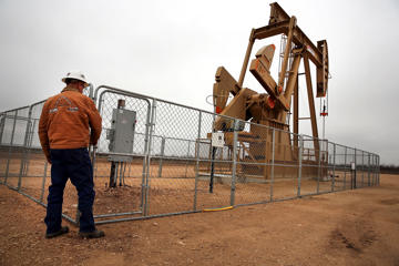 An oil well owned an operated by Apache Corporation in the Permian Basin are viewed on February 5, 2015 in Garden City, Texas.