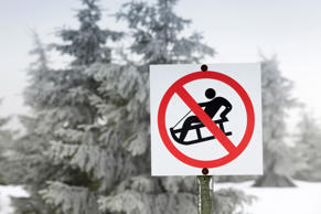 luge warning sign in the mountainson a misty morning