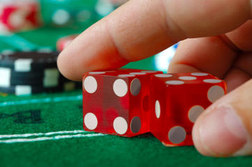 A craps player picks his pair of dice