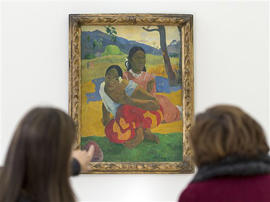 "In this Feb. 6, 2015 picture women look at the painting ""Nafea faa ipoipo?"" (1892) by French painter Paul Gauguin in the Fondation Beyeler in Riehen, Switzerland. The Swiss owners of one of French post-impressionist Paul Gauguin's most famous works from his time in Tahiti say they've sold the painting, but won't reveal the price or buyer. Ruedi Staehelin, who speaks for the Staehelin Family Trust, confirmed to The Associated Press only that the oil painting, called ""Nafea faa ipoipo?"" _ Tahitian for ""When will you marry?"" _ has been sold. Citing unnamed art world insiders, Swiss media had reported earlier this week that the painting was bought by Qatari royalty for $300 million, making it the most expensive painting ever."