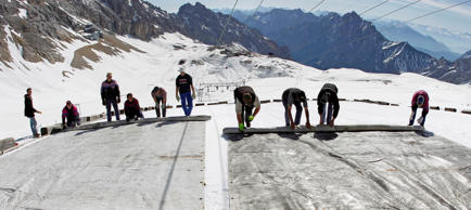 Workers cover a glacier with oversized plastic sheets on the peak of Germany's highest mountain Zugspitze (2962 meters) near Garmisch-Partenkirchen, southern Germany on May 10, 2011. The sheets are meant to keep the glacier from melting during the summer months. It's Plan B in the fight against climate change: cooling the planet by sucking heat-trapping CO2 from the air or reflecting sunlight back into space.