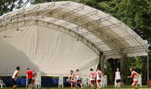 Wombats players perform a drill in front of a concert stage during a Singapore Wombats Aussie Rules training session at Fort Canning Park in Singapore.