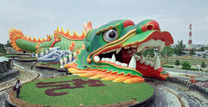 A 60-meter-long dragon swallows an artificial stream at the entrance to the traditional Chinese theme park Haw Par Villa in Singapore.