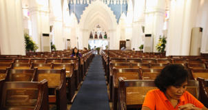 Domestic helper Lisa Padua prays at St Andrew's Cathedral on her day off in Singapore.