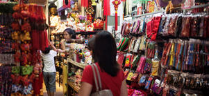 Shoppers browse at a street stall in the area of Chinatown in Singapore.