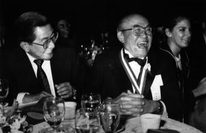 Soichiro Honda (right), founder of the Honda Motor Company, laughs after Chrysler Motor Company Chairman Bennett Bidwell (not pictured) told Honda that he would have less gray hairs if he had not started tinkering with motorcycles, and not threatening to become the third largest automobile company in Oct 10, 1989. The man at left is Honda Motor Company's Deputy General Manager Kiyoshi Ikemi.