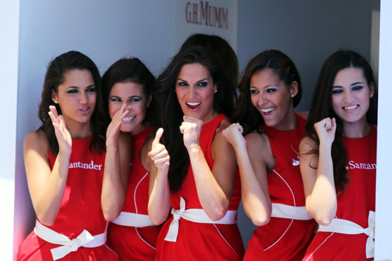 Grid girls are seen in parc ferme following the European Grand Prix at the Valencia Street Circuit on June 24, 2012 in Valencia, Spain.