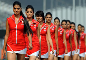 Grid girls pose on the circuit prior to the start of the Formula One Indian Grand Prix in Greater Noida on Octoer 30, 2011.