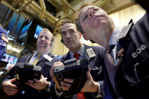 Traders gather at a post on the floor of the New York Stock Exchange, Friday, Ma...