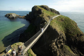 A popular tourist attraction, the rope bridge was built by local fishermen to cross over the 23-metre-deep gorge to check their nets. The bridge acts as the only link between the mainland of Ballintoy and the island of Carrick-a-Rede.
