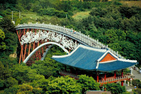 An arch bridge over Cheonjeyeon Waterfall on Jeju Island, it is beautifully deco...