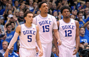 Tyus Jones #5, Jahlil Okafor #15 and Justise Winslow #12 of the Duke Blue Devils look on during their game against the North Carolina Tar Heels at Cameron Indoor Stadium on February 18, 2015 in Durham, N.C.