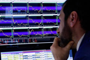 A stock specialist watches screens on the floor of the New York Stock Exchange.
