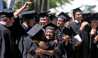 CAMBRIDGE, MA - MAY 30: Harvard graduate Alexandra Marie Garcia hugs a fellow graduate. Harvard's 362nd commencement took place on Thursday, May 30, 2013.