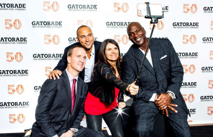 Sports icons Michael Jordan, Peyton Manning Mia Hamm and Derek Jeter are seen taking an all-star selfie at Gatorade's 50th anniversary celebration, Saturday, January 31, 2015, in Paradise Valley, AZ.  The sports fueling company celebrated with an all-star lineup of athletes in recognition of the brand's history.