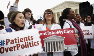 Supporters of the Affordable Care Act gather in front of the U.S Supreme Court during a rally, March 4, 2015 in Washington, DC.
