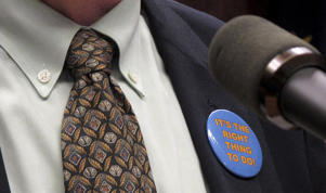 "A pin on Gov. Bill Walker's jacket reading ""It's the right thing to do"" is shown amid expansion of the Medicaid system in Alaska, March 17, 2015, in Juneau, Alaska."