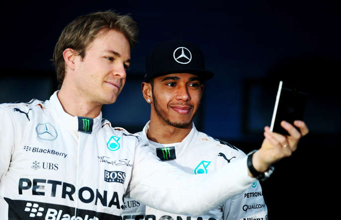Lewis Hamilton of Great Britain and Mercedes GP and Nico Rosberg of Germany and Mercedes GP pose with the new W06 at its launch outside the team garage during day one of Formula One Winter Testing at Circuito de Jerez on February 1, 2015 in Jerez de la Frontera, Spain.