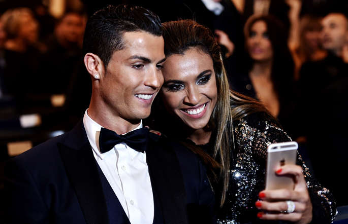 Rosengard's Brazilian forward Marta (R) takes a selfie with Real Madrid and Portugal forward Cristiano during the 2014 FIFA Ballon d'Or award ceremony at the Kongresshaus in Zurich on January 12, 2015.