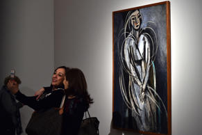 Women pose for a selfie in front of a painting by French artist Henri Matisse during a press preview of the exhibition 'Matisse Arabesque' on March 4, 2015 at the Scuderie del Quirinale museum in Rome.