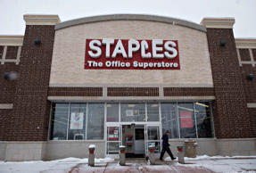 FILE - This Tuesday, March 1, 2016, file photo, shows a Staples store sign in Ne...