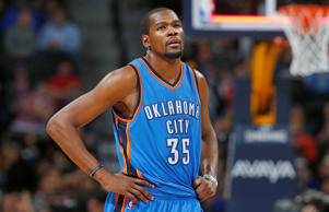 Oklahoma City Thunder forward Kevin Durant checks the scorebaord as he heads to the bench at the end of the third quarter of an NBA basketball game against the Denver Nuggets, Monday, Feb. 9, 2015, in Denver.