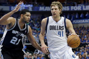 Dallas Mavericks forward Dirk Nowitzki of Germany, drives against San Antonio Sp...