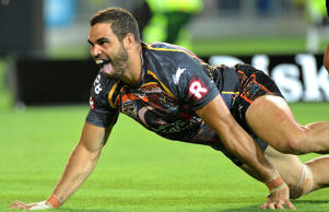Greg Inglis celebrates a classic Indigenous All Stars try with his trademark goanna crawl.