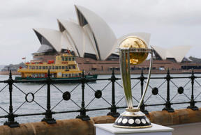 The Cricket World Cup trophy is pictured in front of Sydney's Opera House November 6, 2014, during an event marking the 100-day countdown to the 2015 Cricket World Cup.