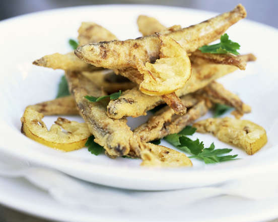 Fresh anchovies, marinated in garlic, vinegar and olive oil, are fried and served with chilled beer. It is a popular tapa dish during the summers.