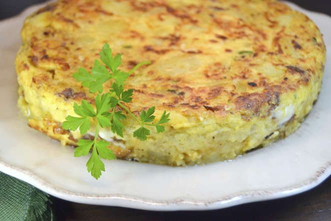 Tortilla Espanola, or Spanish omelette, is one of the best known Spanish tapas. It typically consists of potato chunks, onions and egg. At times, other ingredients like ham may also be added.