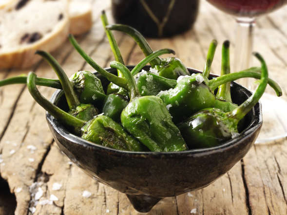 Padron in Spain is famous for its small green peppers. Pimientos de Padron refers to the peppers fried in olive oil and served with a sprinkling of sea salt.