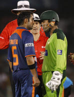 In this Saturday, June 19, 2010 photo, Pakistan's wicketkeeper Kamran Akmal, right, argues with India's Gautam Gambhir during their fourth Asia Cup cricket match in Dambulla, Sri Lanka, Saturday, June 19, 2010. The players argued over a caught behind decision.