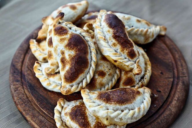 Empanadas are pastries made of dough and filled with stuffing consisting of meat, vegetables and cheese.