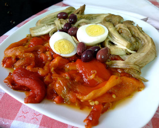 """A traditional Catalan tapas dish, escalivada consists of smoked eggplant, roasted tomatoes, bell peppers, garlic served with olive oil. Its name comes from the Catalan verb escalivar, which means """"to raost in the embers""""."""