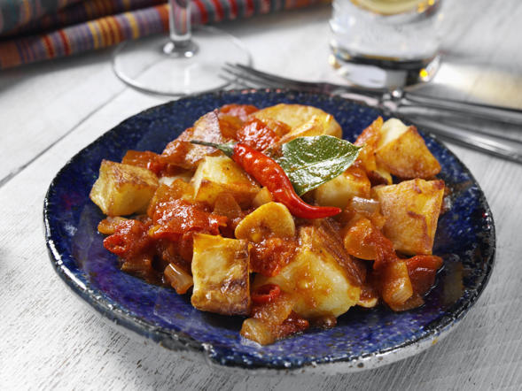 Also called papas bravas, patatas bravas consist of deep-fried potato cubes usually served with a spicy tomato sauce. The type of sauce may vary from region to region.