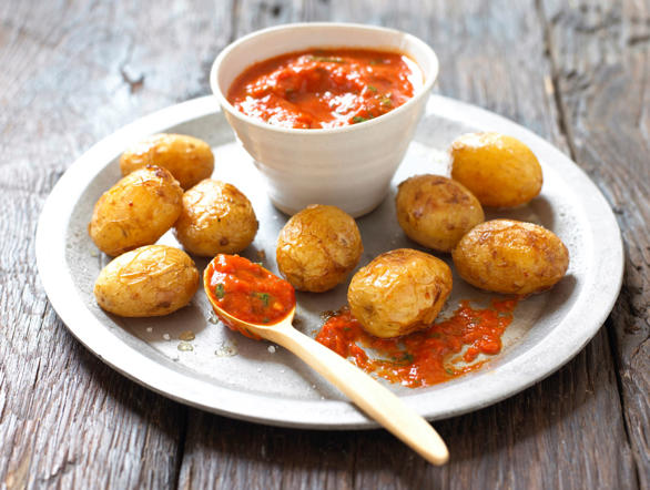 A traditional Canary Islands dish, papas arrugadas is a dish made of small potatoes served with a hot pepper sauce called mojo. The potatoes are baked and roasted with their skin, until they turn wrinkly.