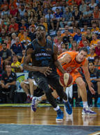 New Zealand's Ekene Ibekwe rounds Cairns Matthew Burston during game one of the 2015 NBL Grand Final series between the Cairns Taipans and the New Zealand Breakers at Cairns Convention Centre on March 6, 2015 in Cairns, Australia.
