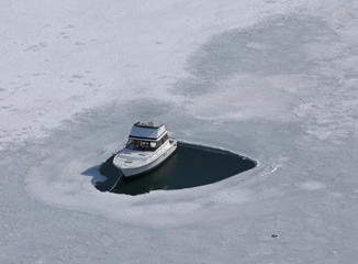 A boat off Winthrop, Massachusetts, on frozen waters on March, 3.