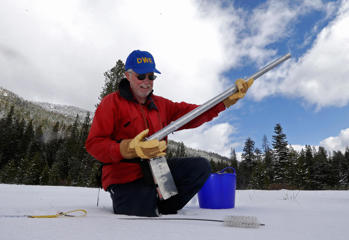 Frank Gehrke, chief of the California Cooperative Snow Surveys Program for the Department of Water Resources, checks the snow survey pole after withdrawing it from the snow pack while conducting the snow survey near Echo Summit, Calif., Tuesday, March 3, 2015.