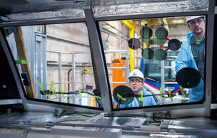 Employees install the windshield of an Amtrak locomotive at the Siemens Industry Inc. manufacturing facility in Sacramento, California, U.S., on Thursday, Feb. 12, 2015. The U.S. Federal Reserve is scheduled to release industrial production figures on Feb. 18.