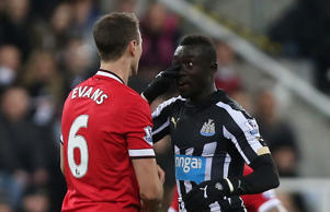 Johnny Evans and Papiss Cisse come together